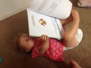 Baby reading Mr Owl