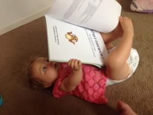 Baby reading Mr Owl