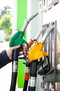 bigstock-Man-holding-a-gasoline-nozzle--26979017