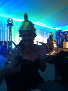 Kate Greaves holding the trophy's her company were awarded on the night and wearing the top award, the perpetual Fire Helmet Award.