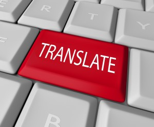 The word Translate on a red computer keyboard key or button to i