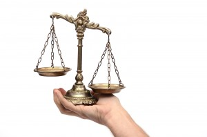 Holding Decorative Scales Of Justice