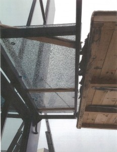 Sheet of toughened glass shattered when it was over tightened during installation.