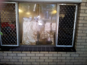 Cooking oil splashed up onto a kitchen window causing a fire hazard.