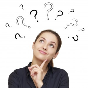 Thinking smiling woman with questions mark above