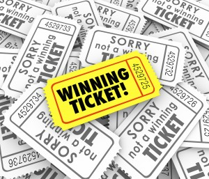 One winning ticket on pile of losing entries in lottery or raffl