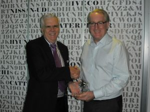 The author presenting the LIM Claims Services Award to NTI's CEO, Mr Tony Clark (right).
